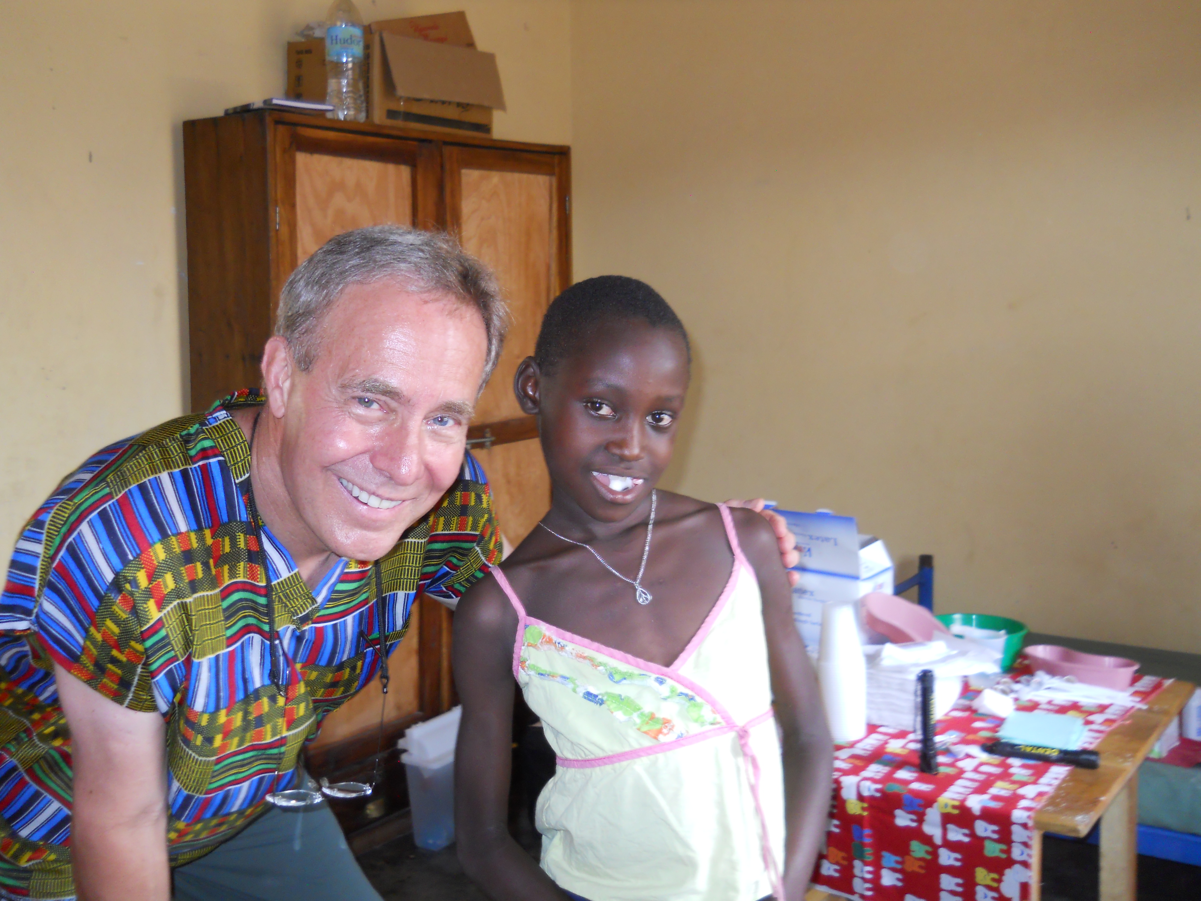 Dr. Hovick with a patient on one of his missions